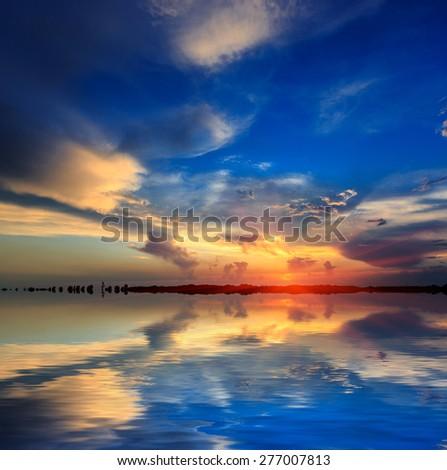Nice sunset scene over water surface - stock photo