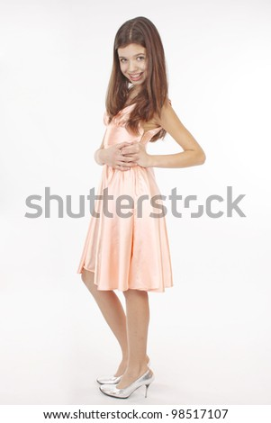 Nice teen girl in pink dress - stock photo