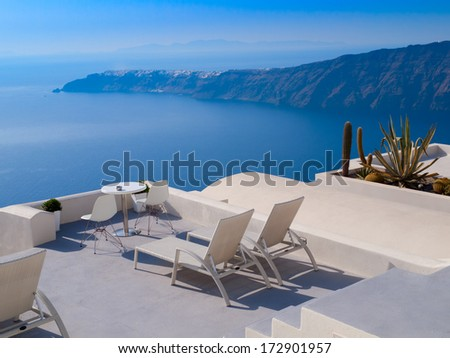 Nice view on blue and  white  hotels and houses of greek island, Santorini, Greece. - stock photo