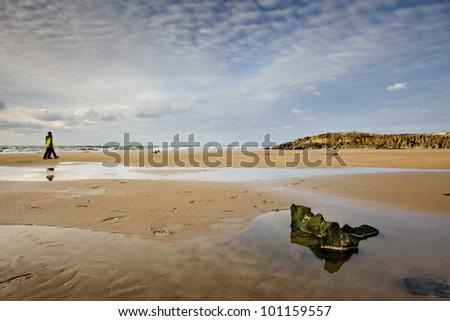 Nice walk on the beach and good light - stock photo