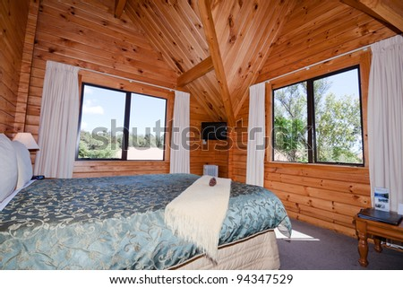 Nice warm interior of mountain wooden lodge apartment. Fox Glacier Lodge, Fox Glacier, West Coast, South Island, New Zealand. - stock photo