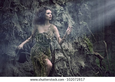 Nice woman as a part of tree - stock photo