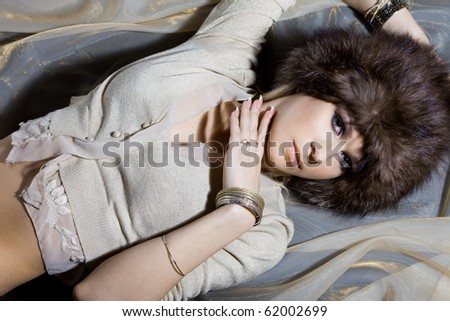 nice woman in a fur hat - stock photo