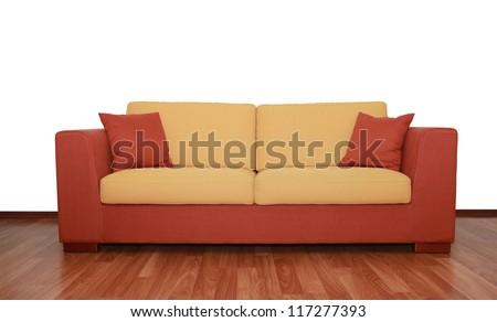 nice yellow-orange textile sofa with pillows - stock photo