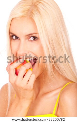 Nice young woman bites off ripe apple and laughs, it is isolated on white background. - stock photo