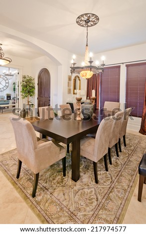 Nicely decorated living ( lunch ) room. Dining table and some chairs. Vertical. - stock photo