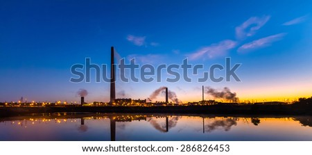 Nickel plant with graduated sunrise sky as background - stock photo