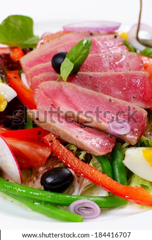 Nicoise with fresh tuna and vegetables close-up - stock photo