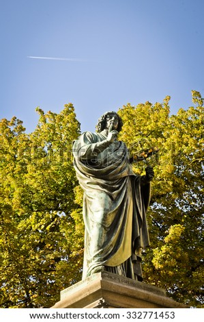 Nicolaus Copernicus with astrolabe and jet plane on the background - stock photo
