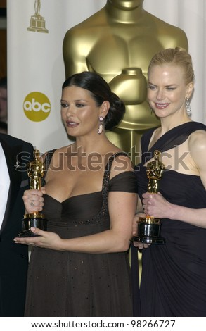 NICOLE KIDMAN (right) & CATHERINE ZETA-JONES at the 75th Academy Awards at the Kodak Theatre, Hollywood, California. March 23, 2003 - stock photo