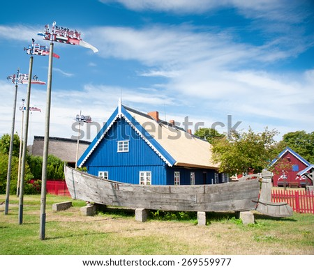 Nida. Traditional fisherman's house in Nida, Lithuania. Nida is a resort town in Lithuania. Located on the Curonian Spit between the Curonian Lagoon and the Baltic Sea. Unesco Heritage. - stock photo