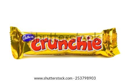 NIEDERSACHSEN, GERMANY FEBRUARY 17.02.2015: A single Cadbury crunchie chocolate bar sealed on a white background - stock photo