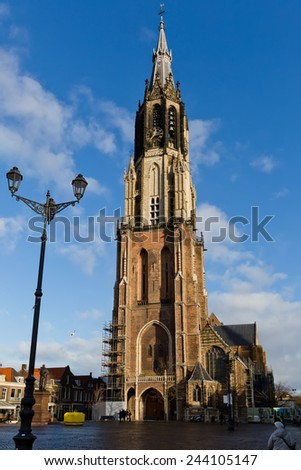 Nieuwe Kerk is a landmark Protestant church in Delft, Netherlands. The building is located on Delft Market Square, opposite to the City Hall. The church tower is the second highest in the Netherlands. - stock photo