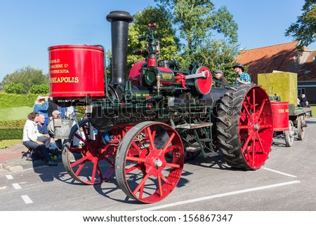 NIEUWEHORNE, THE NETHERLANDS - SEP 28: Old steam tractor in a countryside parade during the agricultural festival Flaeijel on September 28, 2013, the Netherlands - stock photo