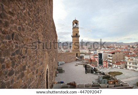 NIGDE, TURKEY - JANUARY 31: Nigde city center and clock tower from Nigde Castle on January 31, 2015 in Nigde, Turkey. Nigde at Central Anatolia in Turkey. - stock photo