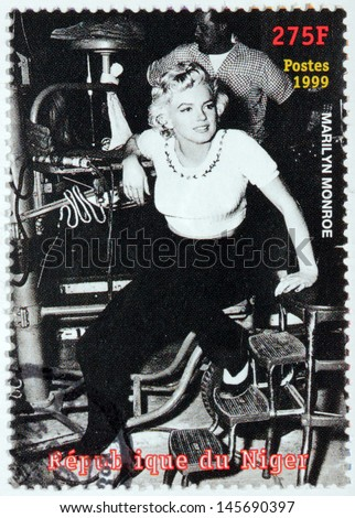 NIGER - CIRCA 1999: A postage stamp printed by NIGER shows image portrait of famous American actress, model and singer Marilyn Monroe (1926-1962), circa 1999 - stock photo