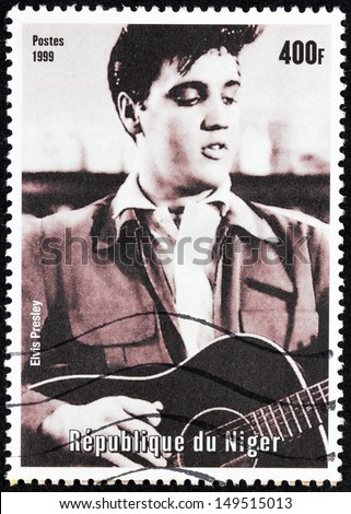 NIGER - CIRCA 1999: A postage stamp printed by NIGER shows image portrait of famous American singer Elvis Presley, circa 1999. - stock photo