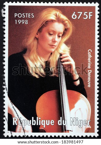NIGER - CIRCA 1998: A stamp printed by NIGER shows image portrait of famous French actress Catherine Deneuve, circa 1998 - stock photo