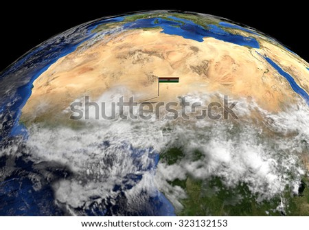 Niger flag on pole on earth globe illustration - Elements of this image furnished by NASA - stock photo
