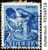 NIGERIA - CIRCA 1961: A stamp printed in Nigeria, shows pottery, circa 1961 - stock photo