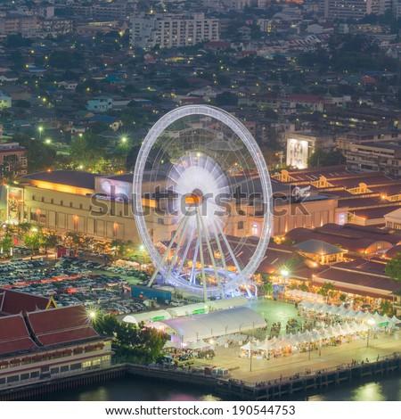 Night, a rotating Ferris wheel - stock photo