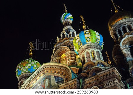 Night and close view of Church on Spilled Blood domes in Saint Petersburg, Russia. Black background - stock photo