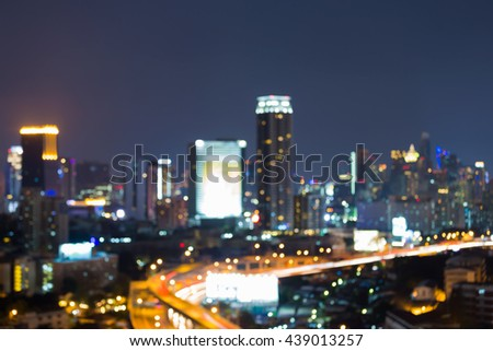Night blurred bokeh lights city and road, abstract background - stock photo