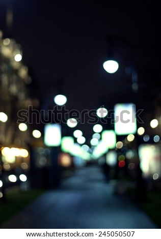 night city life: alley and street lamps - stock photo