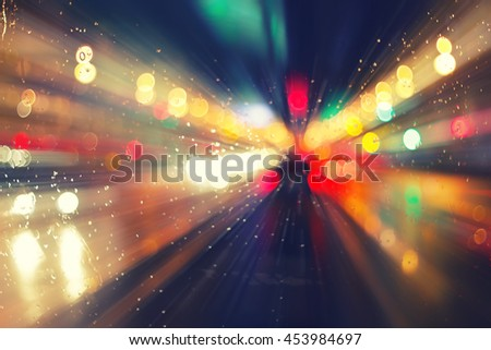 night city road through windshield: cars, lights and rain, vintage style photography - stock photo