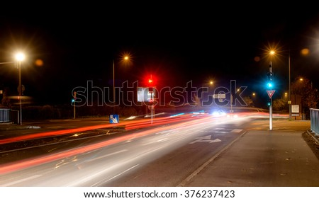 Night city, roadway , lighting street lights blurred traces of headlights of passing cars - stock photo