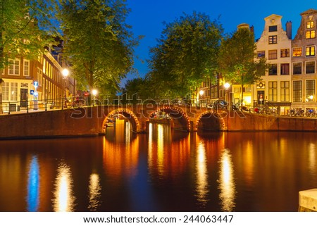 Night city view of Amsterdam canal and bridge, Holland, Netherlands. - stock photo