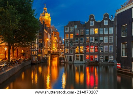 Night city view of Amsterdam canal, bridge and church, Holland, Netherlands. Long exposure.  - stock photo