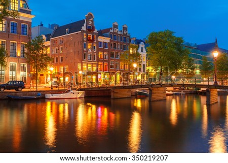 Night city view of Amsterdam canal, typical dutch houses and bridge, Holland, Netherlands. - stock photo