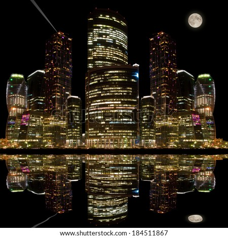 Night city view with its reflection in the water of the river. - stock photo