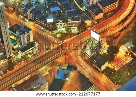 Night cityscape of cross road traffic - stock photo