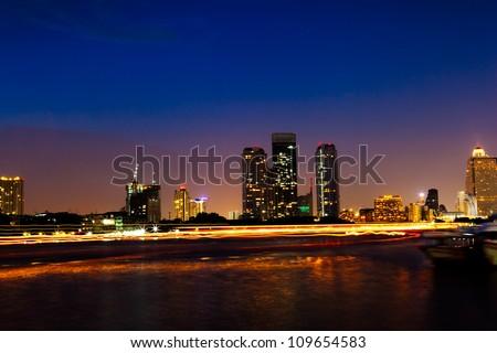 Night CityScape the building near Chaophaya river,Bangkok,Thailand - stock photo