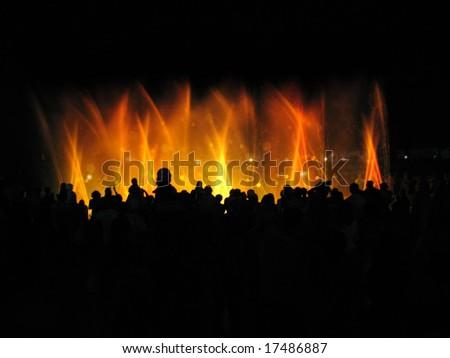 night club party; people near fountain in night - stock photo