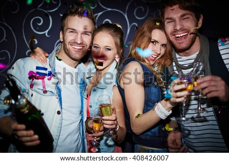 Night clubbers with champagne - stock photo