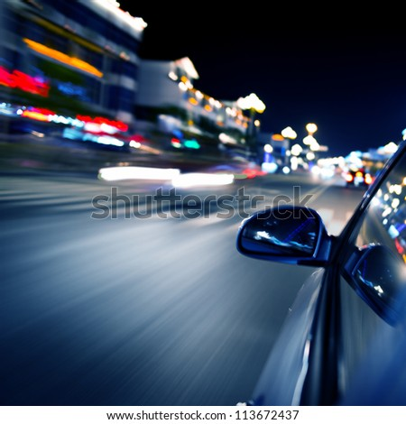 night drive ,shoot from the window of speed car, motion blur steet light. - stock photo