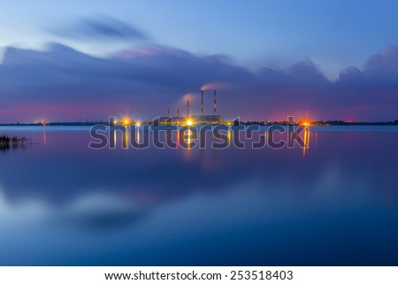 Night electric station in lake reflection - stock photo