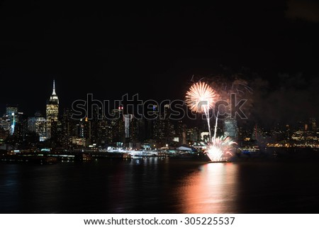 Night fireworks on Hudson River with New York skyline on background - stock photo