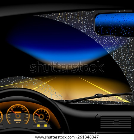 Night highway in rain from inside of the car - stock photo