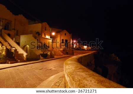 Night in Matera, Italy, on the Via Madonna Delle Virtu at the Edge of the Ravine - stock photo