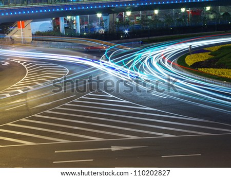 Night in Shanghai traffic light trails - stock photo