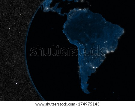 Night in South America with city lights viewed from space. Elements of this image furnished by NASA. - stock photo