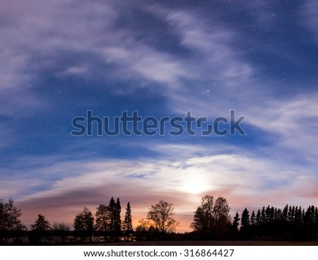 Night landscape panorama and cloudy starry sky and moon - stock photo