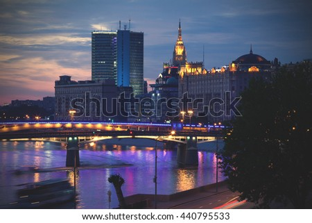night landscape with Borodino road bridge and Smolensky Metro Bridge in Moscow, Russia. Moscow river and motion ship. long exposure of shutter speed. instagram image filter retro style - stock photo