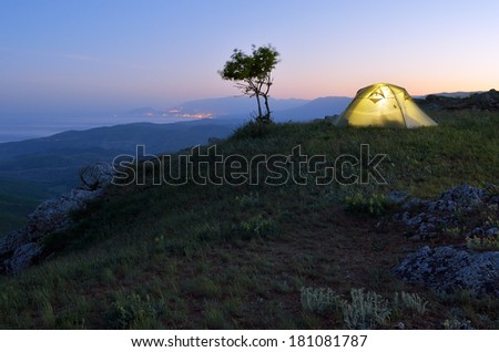 Night landscape with tourist tent. Camping in the mountains - stock photo