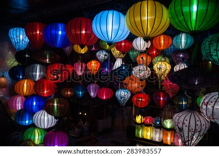 Night lanterns in old Hoi An town in Vietnam. Background of ancient eastern culture. Multiple colors and bright lights. - stock photo