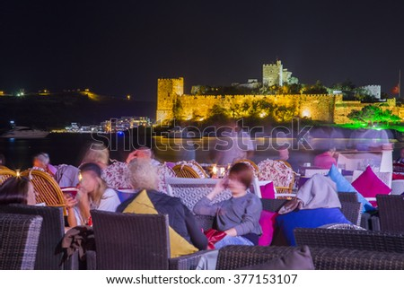 Night life in Bodrum with view of Bodrum Castle - stock photo